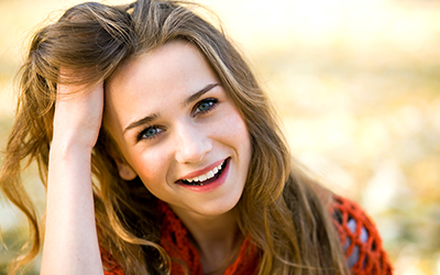 Young teenage girl smiling