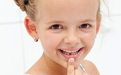Child with missing tooth