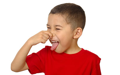 Child plugging his nose